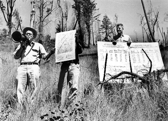 Forestry Advisor Robert Krohn with soil charts, c. 1965