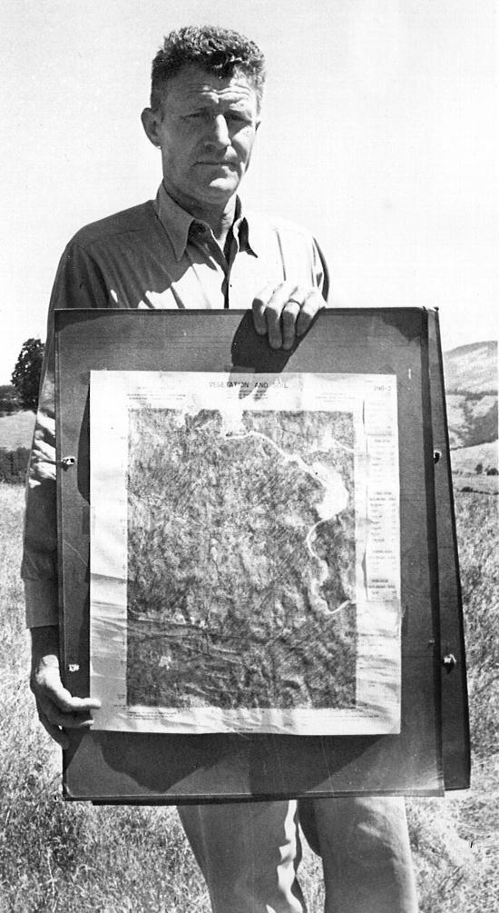 Forestry Advisor Robert Krohn with vegetation map, c. 1965